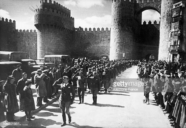 German Volunteers From The Condor Legion Marching Ahead Of The Soldiers Of The National Spanish Army At The Foot Of The Old Wall Which Surrounds The...