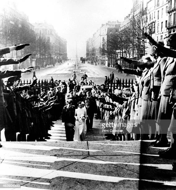 German wedding at the chuch of la Madeleine Paris 19401944 Guests giving Nazi salutes as the bridal party approaches