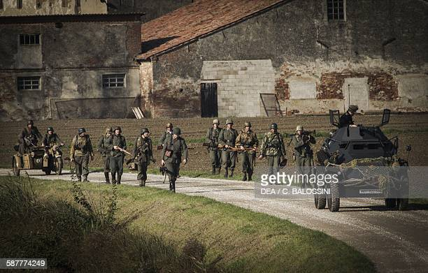 German Wehrmacht soldiers on patrol led by a SdKfz222 armoured car Italian front Second World War 20th century Historical reenactment