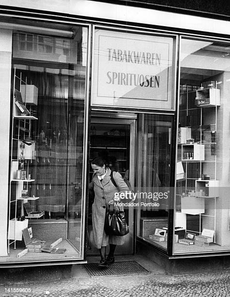A German woman leaving a tobacco and liquor shop in East Berlin East Berlin August 1961