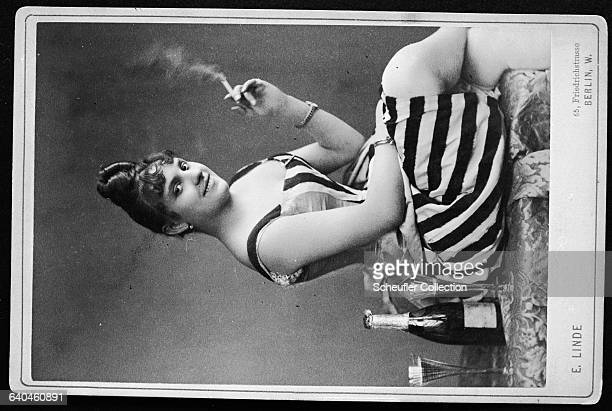 A German woman poses for a photograph holding a cigarette