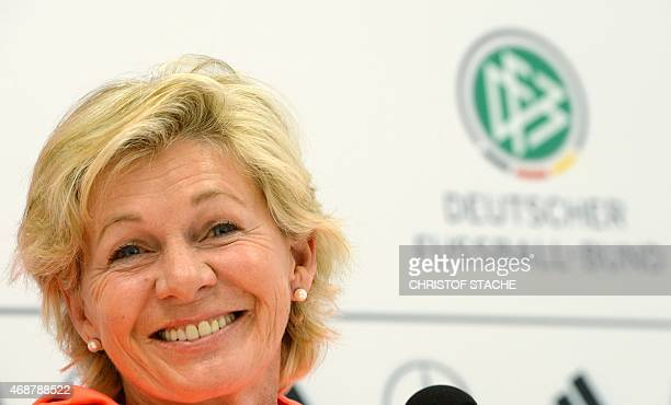 German women's headcoach Silvia Neid laughs during a news conference of the German Women national football team in Fuerth southern Germany on April 7...