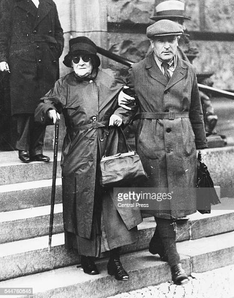 German women's rights activist Clara Zetkin being helped down the steps of a church, 1932.
