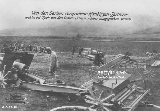German World War I photographic postcard depicting Austrian soldiers excavating weapons buried by Serbian troops, 1915. From the New York Public...