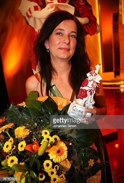 German writer Andrea Maria Schenkel poses on stage after the annual Corine awards at the Prinzregenten Theatre on September 16, 2007 in Munich,...