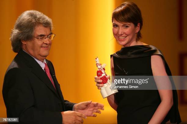 German writer Anne Siemens receives the Corine trophy from award presenter Helmut Markwort during the annual Corine awards at the Prinzregenten...