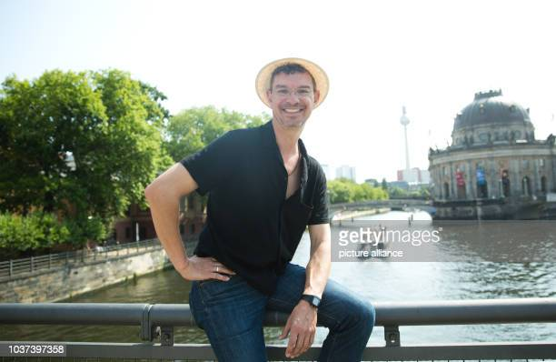 German writer Christian Seltmann poses on the Ebertbruecke bridge inBerlinGermany 24 July 2015 His new book entitled 'Where the fuck is the...