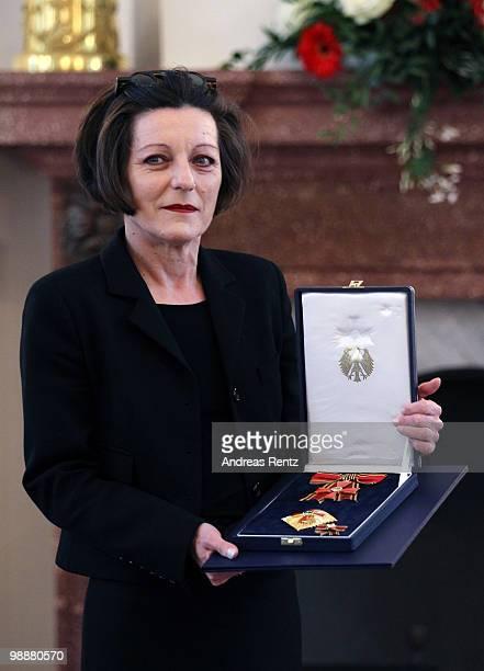 German writer Herta Mueller holds the Federal cross of Merit at Bellevue palace on May 6 2010 in Berlin Germany German President Horst Koehler...