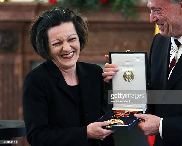 German writer Herta Mueller receives the Federal cross of Merit by German President Horst Koehler at Bellevue palace on May 6 2010 in Berlin Germany...