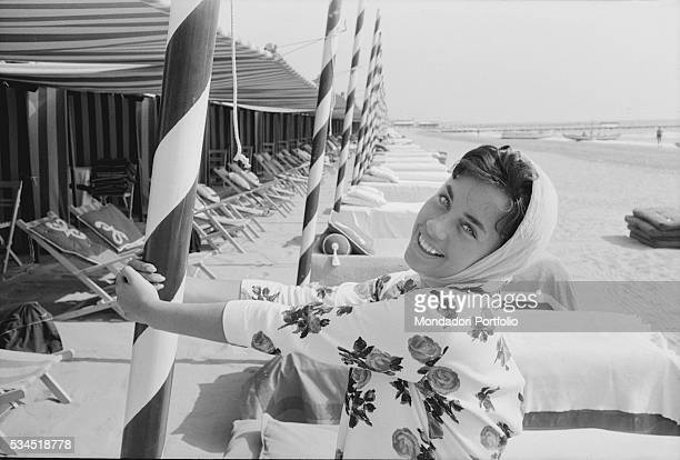 German writer Vera Tschechowa smiling leaning against a pole at the lido during the 19th Venice International Film Festival Venice August 1958