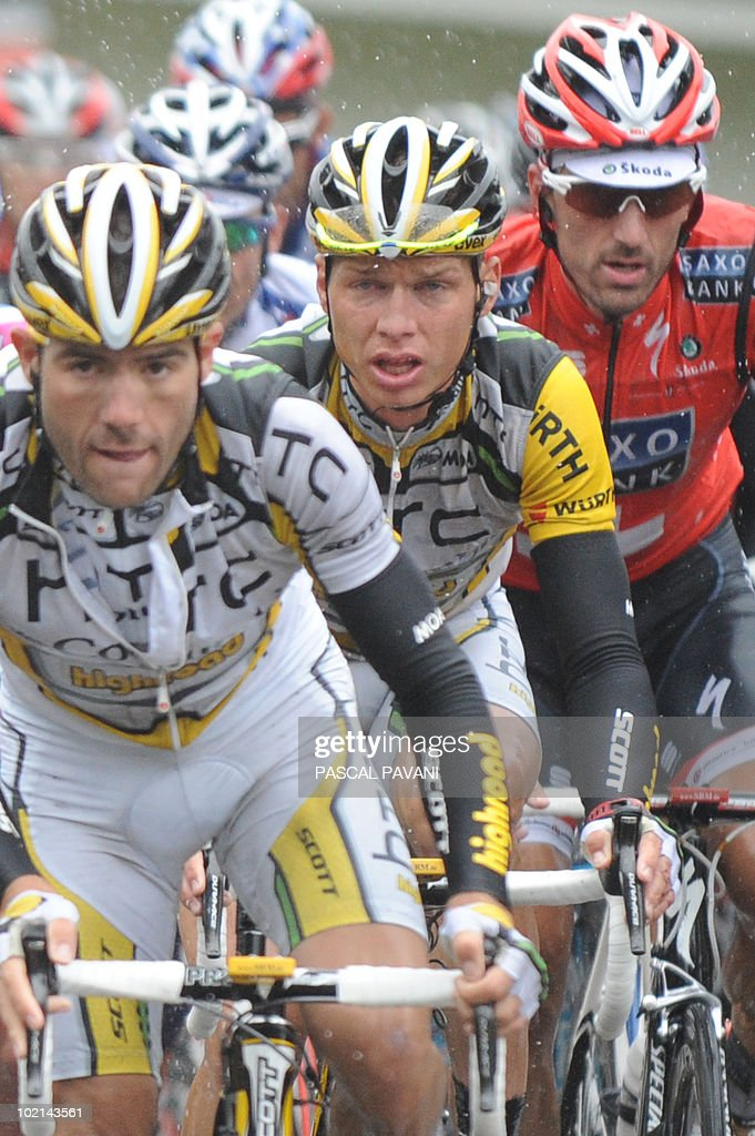 German yellow jersey leader Tony Martin (C) and Swiss second placed Fabian Cancellara (R) ride during the fifth stage of the Tour de Suisse cycling race on June 16, 2010. BMC's Marcus Burghardt claimed his first major win of the season when he dominated the rain-hit fifth stage of the Tour of Switzerland today.