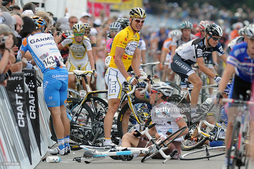German yellow jersey Tony Martin (C) stands after a crash during the sprint near the finish line on the four stage Schawarzenburg - Wettingen of the Tour de Suisse (Tour of Switzerland) cycling race on June 15, 2010.