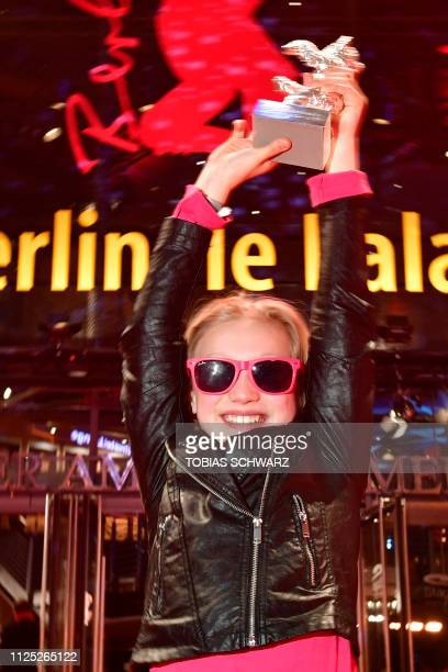 German young actress Helena Zengel poses with the Silver Bear Alfred Bauer Prize for the film System Crasher on the red carpet after the awards...