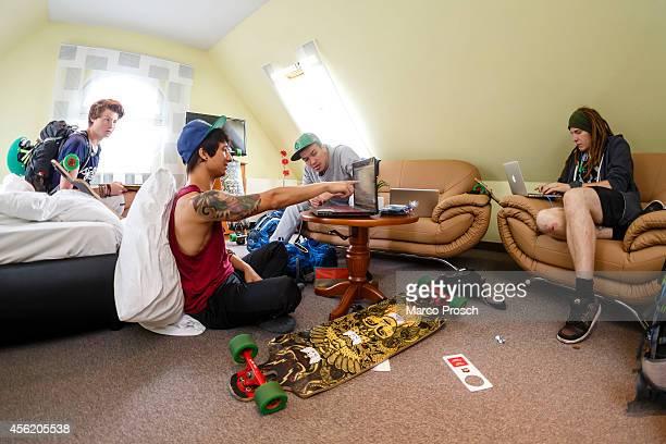"""German Youtube stars Felix """"DNER"""" von der Laden, Julien Bam, Cheng Loew and Simon """"Ungespielt"""" Unge sit in their hotel room on September 27, 2014..."""