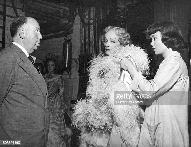 German-American actress Marlene Dietrich and American actress Jane Wyman, with British director and producer Alfred Hitchcock on the set of his movie...