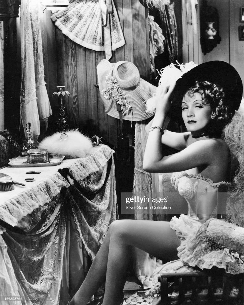 German-American actress Marlene Dietrich (1901 - 1992) as Frenchy in a publicity still for 'Destry Rides Again', directed by George Marshall, 1939.