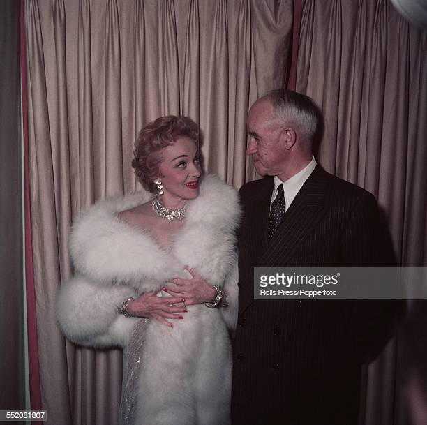German-American actress Marlene Dietrich pictured backstage with General Omar Bradley of the United States Army during her cabaret residency at the...