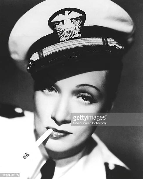 GermanAmerican actress Marlene Dietrich smoking a cigarette and wearing a sailor's cap in a promotional portrait for 'Seven Sinners' directed by Tay...