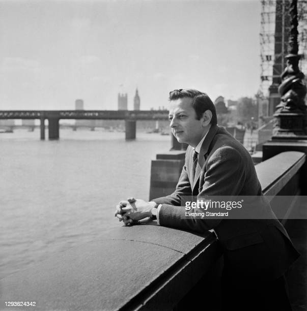 German-American pianist and conductor André Previn on the River Thames in London, UK, 4th May 1966.