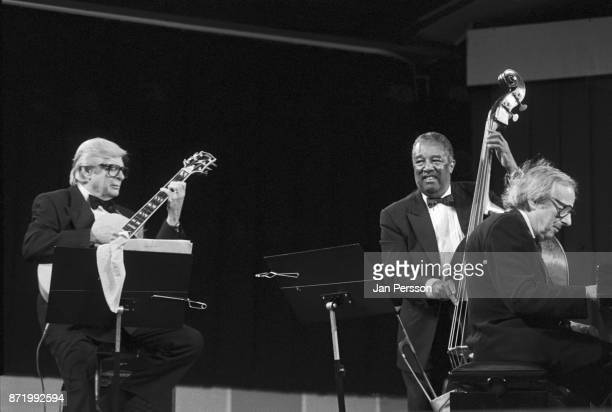 German/American pianist conductor and composer Andre Previn performing with guitarist Mundell Lowe and bassist Ray Brown at The Tivoli Gardens...