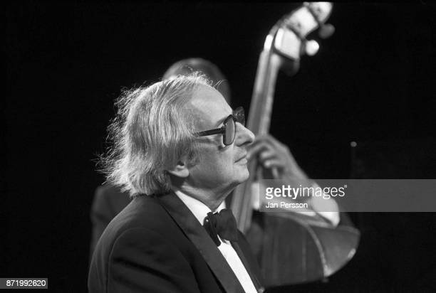 German/American pianist conductor and composer Andre Previn performing with bassist Ray Brown at The Tivoli Gardens Copenhagen Denmark 1995