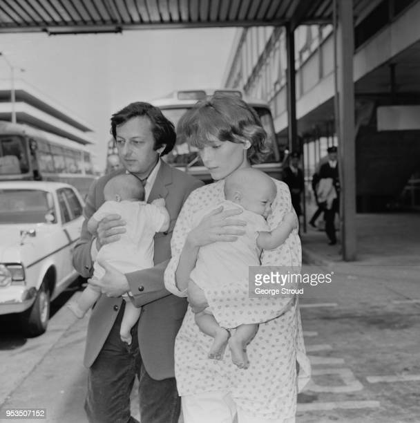 GermanAmerican pianist conductor and composer Andre Previn with his partner American actress and former fashion model Mia Farrow and their two twins...