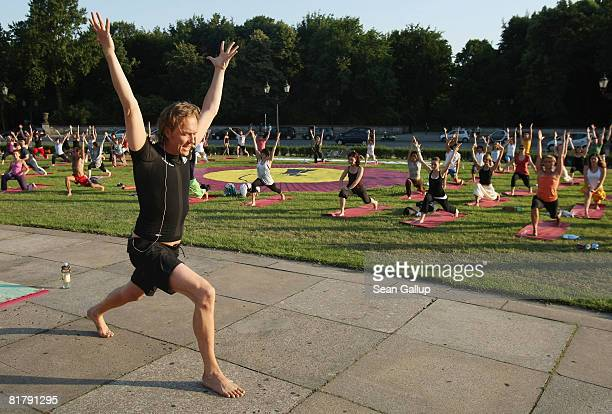 GermanAmerican yoga guru Patrick Broome who is also the yoga coach for the German national football team leads yoga enthusiasts taking part in the...