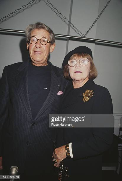 GermanAustralian photographer Helmut Newton and his wife Australian actress and photographer June Newton attending a party being held in Helmut's...