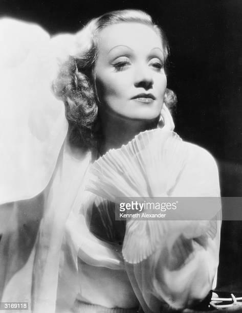 German-born actress Marlene Dietrich in a filmy white gown.