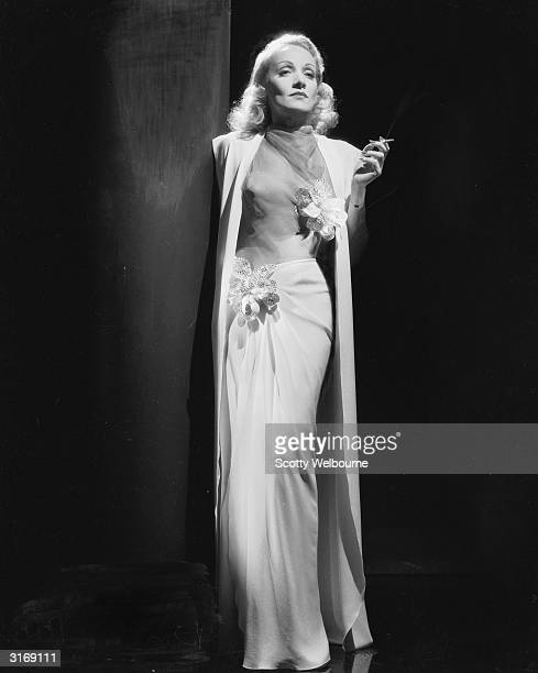 German-born actress Marlene Dietrich wearing an elegant white dress.