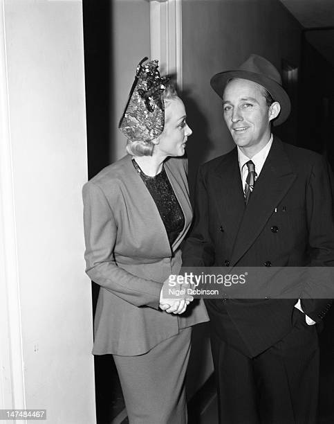 Germanborn American actress and singer Marlene Dietrich shakes hands with American singer and actor Bing Crosby at an unspecified event 1940 or 1950s
