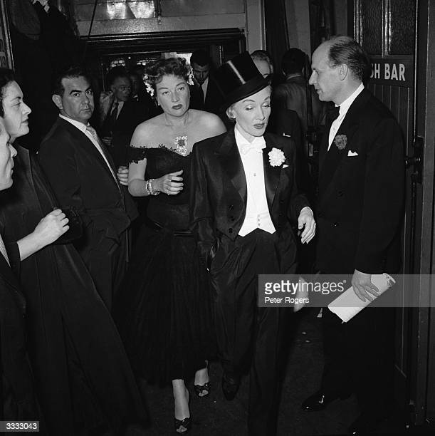 Germanborn American actress Marlene Dietrich walks past guests at the London Palladium for the charity variety performance 'Night Of A Hundred Stars'
