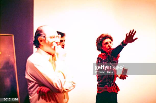 Germanborn American art dealer and gallery owner Andre Emmerich listens to American abstract expressionist artist Helen Frankenthaler New York New...