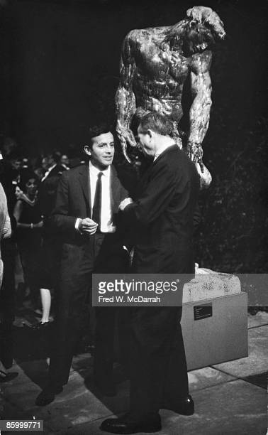 Germanborn American artist Friedel Dzubas and American artist Landes Lewitin talk together at an event in the garden of the Museum of Modern Art New...