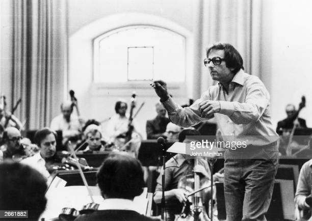 Germanborn American conductor and composer Andre Previn musical director of the London Symphony Orchestra conducting the LSO at Southwark London