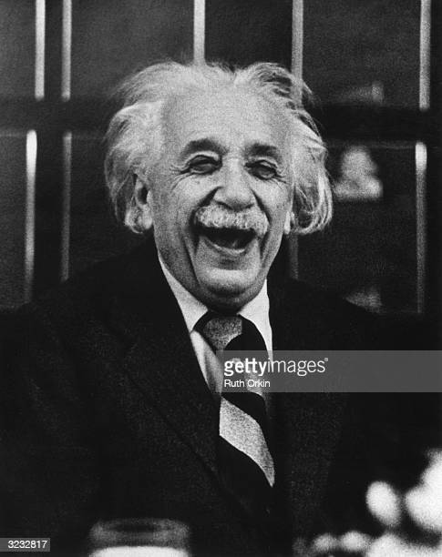 Germanborn American physicist Albert Einstein laughs at a luncheon Princeton New Jersey