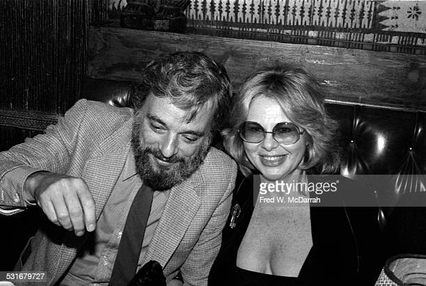 Germanborn American talent agent Sue Mengers sits with composer and lyricist Stephen Sondheim at an unidentified restaurant for a 'Kon Tiki' event...