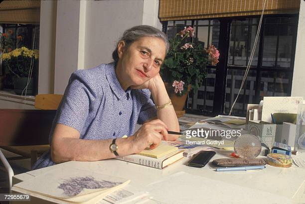 Germanborn AngloAmerican novelist and screenwriter Ruth Prawer Jhabvala sits at a desk with her head on her hand in an apartment New York City late...