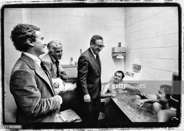 Germanborn diplomat and former US Secretary of State Henry Kissinger and his son David talking to two members of the Cosmos soccer team Germanborn...
