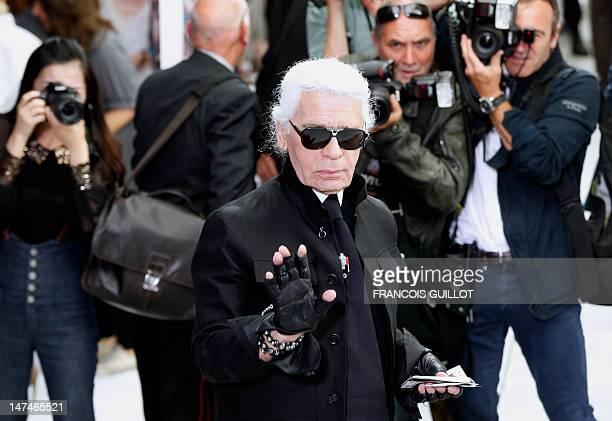 Germanborn fashion designer Karl Lagerfeld attends the men's springsummer 2013 fashion collection show of Belgian designer Kris Van Assche for the...