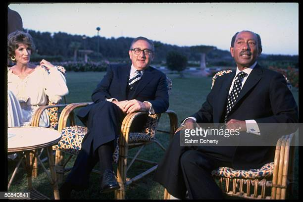 Germanborn former US Secretary of State Henry Kissinger and wife Nancy sitting with Egyptian President Anwar Sadat outside Alexandria Egypt July 1979
