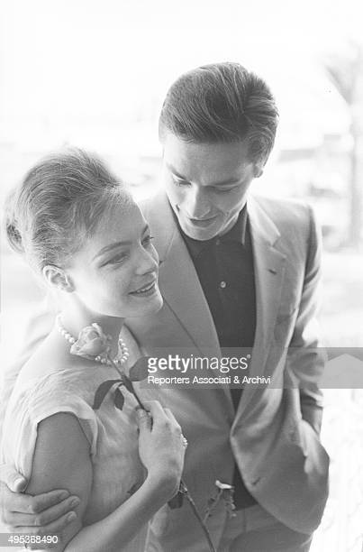 Germanborn French actress Romy Schneider and French actor director and singer Alain Delon hugging each other The couple is in Cannes for the 15th...