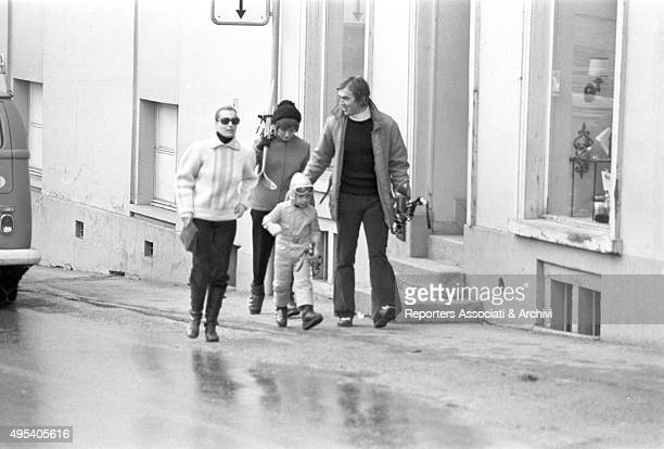 Germanborn French actress Romy Schneider walking in the city centre with her son David Haubenstock and some other friends St Moritz 1971