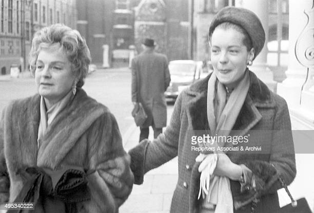 Germanborn French actress Romy Schneider walking in the streets of Cannes with her mother and German actress Magda Schneider Cannes 1962