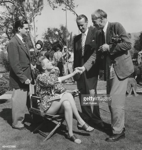 German-born photographer Kurt Hutton and Picture Post journalist Lionel Birch meet American actress Peggy Dow on the set of 'You Never Can Tell',...