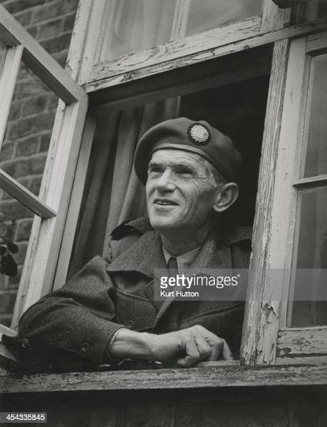 German-born photographer Kurt Hutton in Press Corps uniform at his home in Hampstead Garden Suburb, London, 1946. Hutton first worked for the Dephot...
