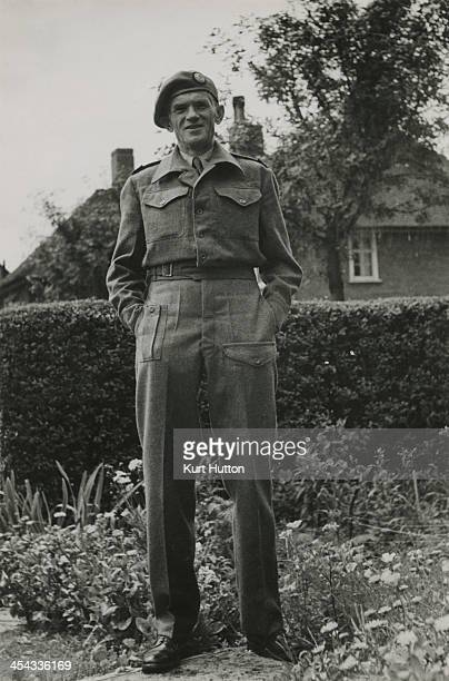 German-born photographer Kurt Hutton in Press Corps uniform at his home in Hampstead Garden Suburb, London, circa 1945. Hutton first worked for the...