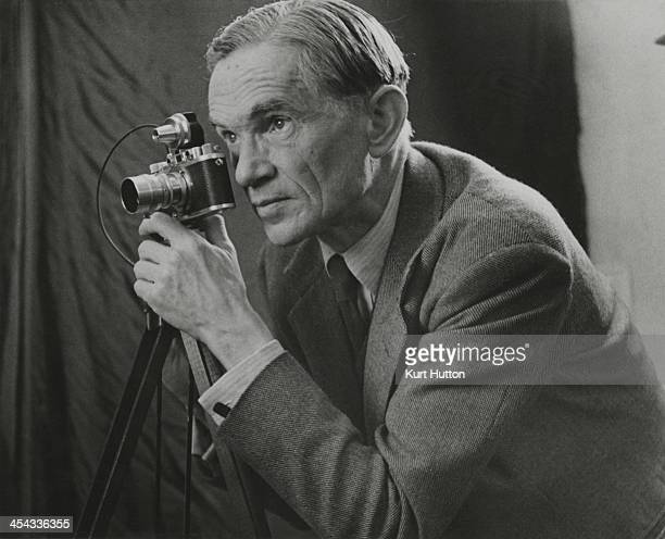 Germanborn photographer Kurt Hutton using a tripodmounted Leica camera circa 1950