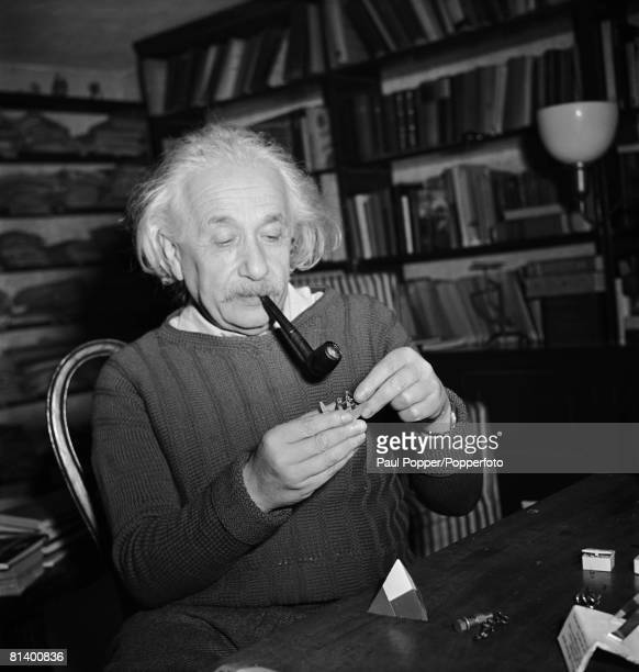 Germanborn physicist Albert Einstein experimenting with geometrical models in his office United States 1944