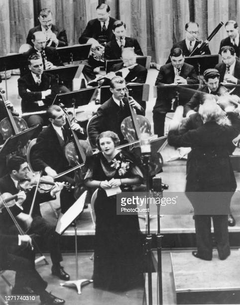 German-born soprano Lotte Lehmann performs with Italian conductor Arturo Toscanini and an unspecified orchestra for a radio broadcast as part of the...